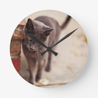Black Cat Rubs Against A Brick Wall Wall Clock