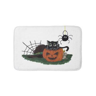Black Cat sits on a Jack o Lantern with Spider Bath Mat
