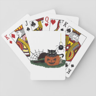 Black Cat sits on a Jack o Lantern with Spider Playing Cards