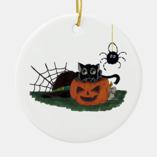 Black Cat sits on a Jack o Lantern with Spider Round Ceramic Ornament