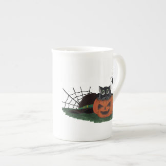 Black Cat sits on a Jack o Lantern with Spider Tea Cup