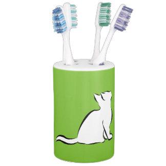 Black cat, white fill soap dispenser and toothbrush holder
