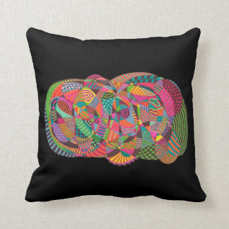 black cushion with abstract design of colors