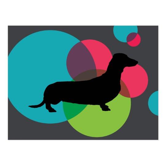 Black dachshund with bright dot pattern postcard