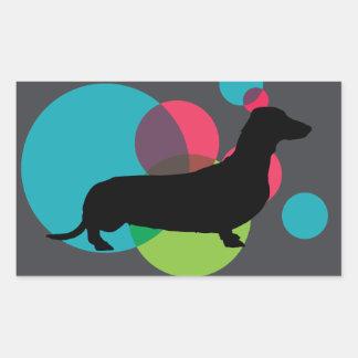 Black dachshund with bright dot pattern rectangular sticker