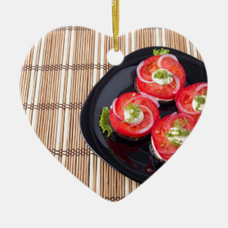 Black dish with sliced tomatoes and lettuce ceramic heart ornament