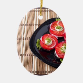 Black dish with sliced tomatoes and lettuce ceramic oval ornament