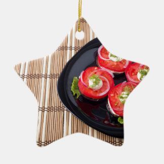 Black dish with sliced tomatoes and lettuce ceramic star ornament