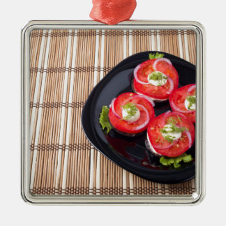 Black dish with sliced tomatoes and lettuce Silver-Colored square ornament