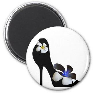 Black elegant high-heeled shoes. Fantasy of high f Magnet
