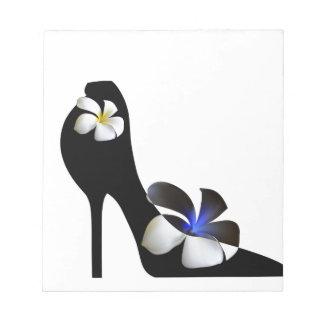 Black elegant high-heeled shoes. Fantasy of high f Notepad