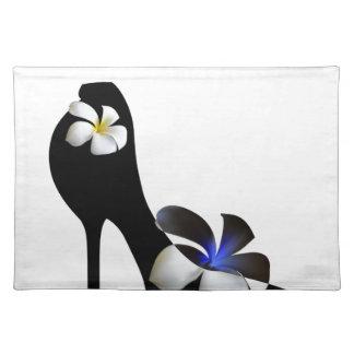 Black elegant high-heeled shoes. Fantasy of high f Placemat