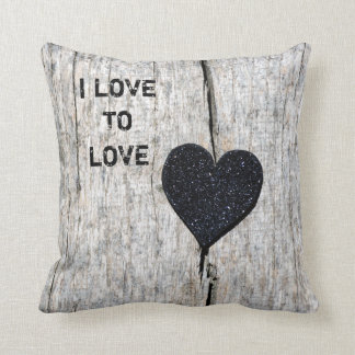 Black glitter heart on rustic wood throw pillow