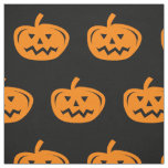 Black Halloween fabric with carved orange pumpkins