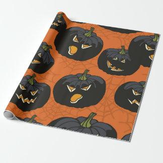 Black Halloween Pumpkins on Orange Wrapping Paper