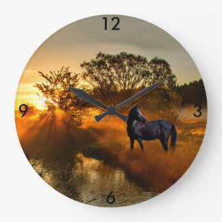 Black horse at sunrise or sunset wall clock