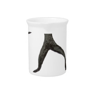 Black human wax model on white background pitcher