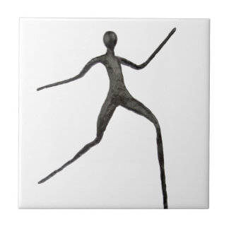 Black human wax model on white background tiles