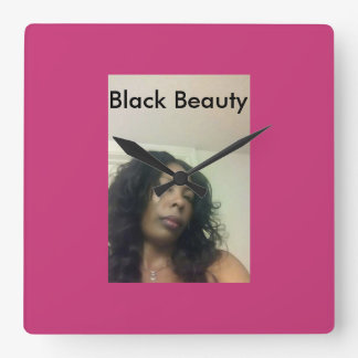 Black is beautiful even with a black hand on it. square wall clock