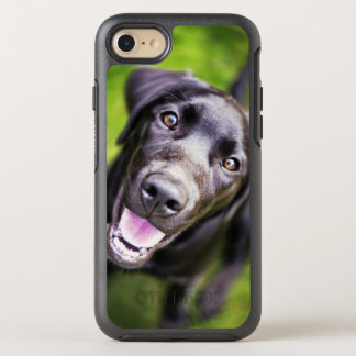 Black labrador puppy looking upwards, close-up OtterBox symmetry iPhone 7 case