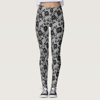Black lace pattern on white background leggings
