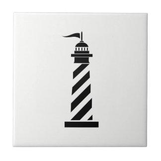 Black Lighthouse on White Ceramic Tile