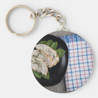 Black plate and baked slices of chicken meat basic round button keychain