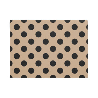 Black polka dots on beige doormat