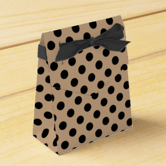 Black polka dots on beige party favor boxes