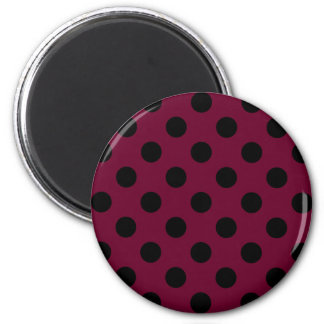 Black polka dots on burgundy 2 inch round magnet