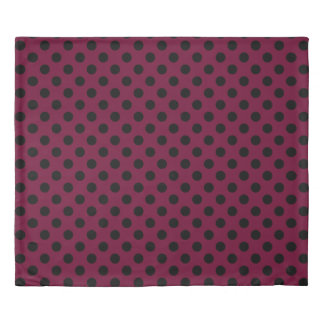 Black polka dots on burgundy duvet cover