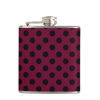 Black polka dots on burgundy flask