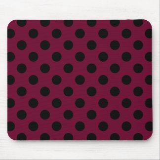 Black polka dots on burgundy mouse pad