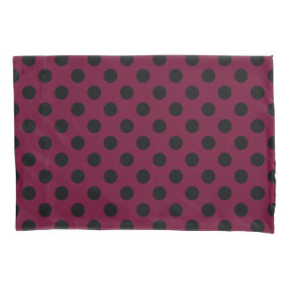 Black polka dots on burgundy pillowcase