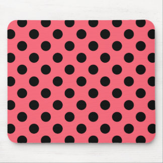 Black polka dots on coral mouse pad
