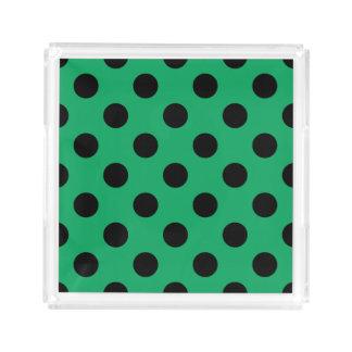 Black polka dots on fresh green serving tray