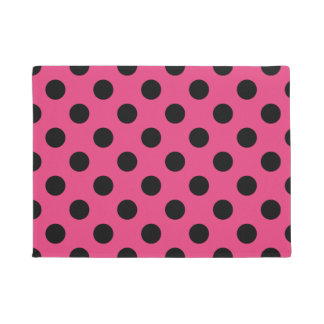 Black polka dots on fuchsia doormat