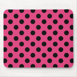 Black polka dots on fuchsia mouse pad
