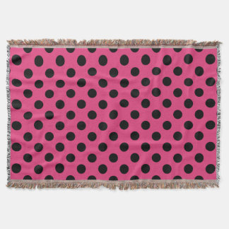 Black polka dots on fuchsia throw blanket