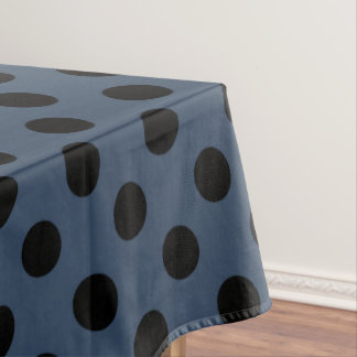 Black polka dots on grey-blue tablecloth