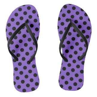 Black polka dots on lavender flip flops