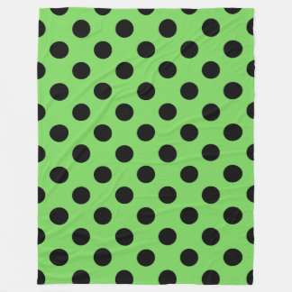 Black polka dots on lime green fleece blanket