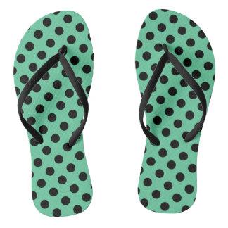Black polka dots on mint green flip flops