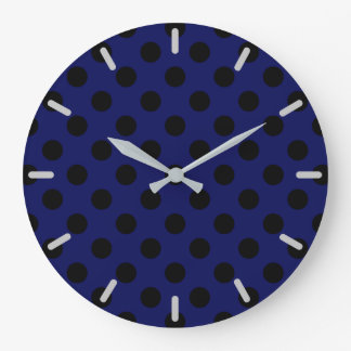 Black polka dots on navy blue clock