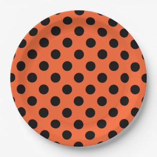 Black polka dots on orange 9 inch paper plate
