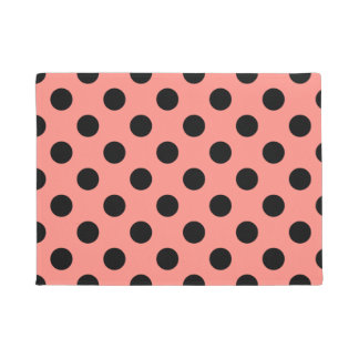 Black polka dots on peach doormat