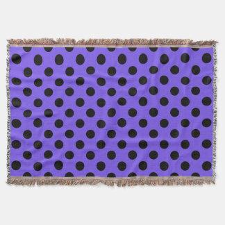 Black polka dots on periwinkle throw