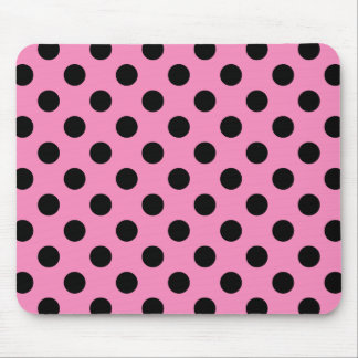 Black polka dots on pink mouse pad
