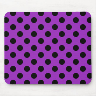 Black polka dots on purple mouse pad