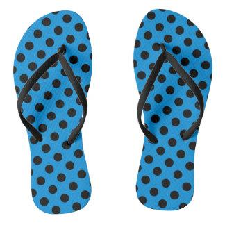 Black polka dots on sky blue flip flops